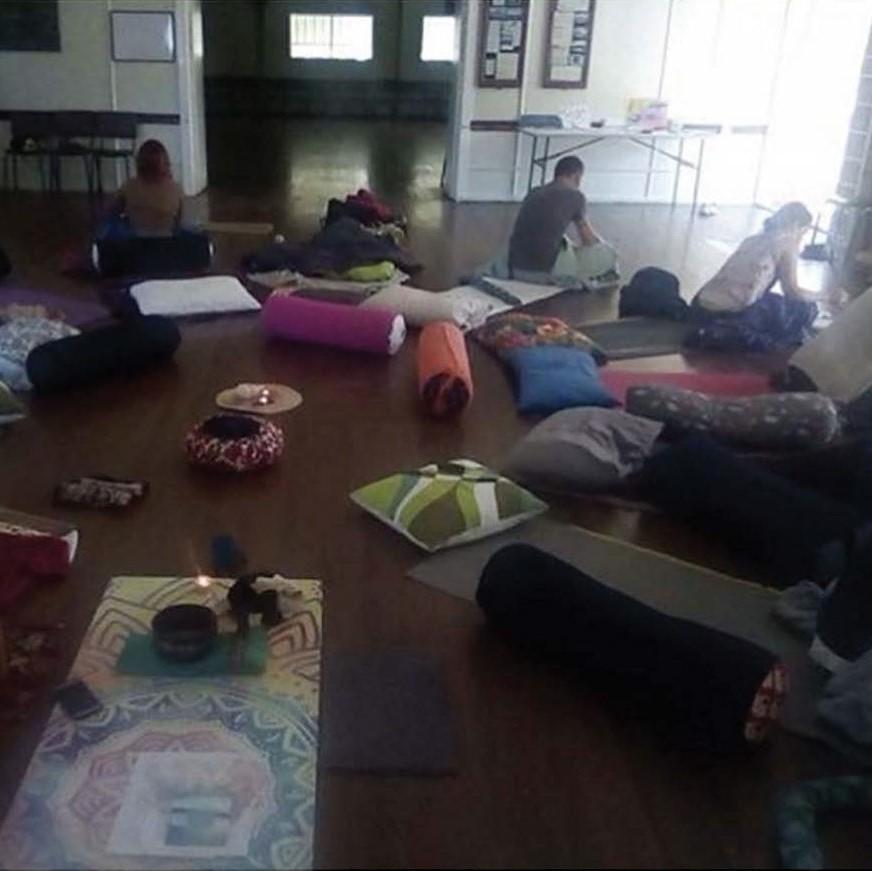 Image of people practising Yoga Nidra